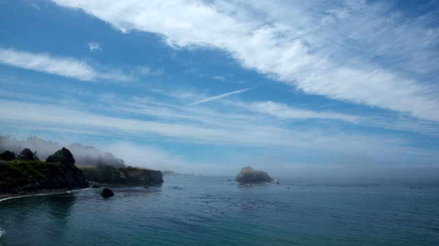 ws t/l view of clouds moving in sky over pacific ocean, mist and fog rolling in / mendocino, california, united states - horizon stock-videos und b-roll-filmmaterial