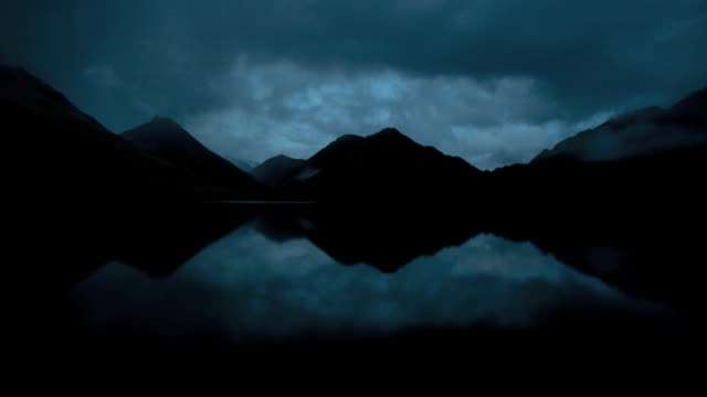 WS T/L View of clouds moving over Moke Lake at dawn, mountains in background / Queenstown, South Island, New Zealand
