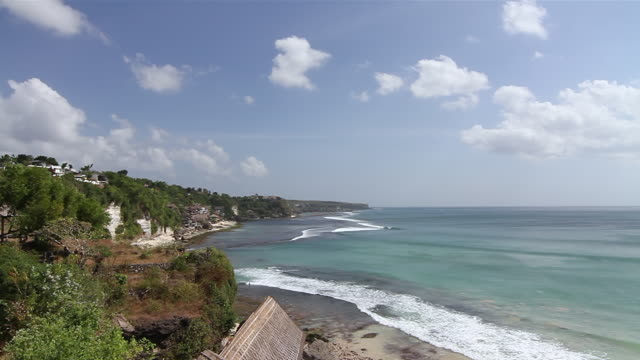 WS T/L View of clouds moving over ocean and coast / Padang Padang, Bali, Indonesia