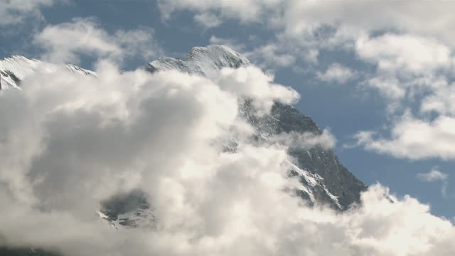 ws t/l view of clouds over eiger mountain / grindelwald, bernese alps, switzerland - berner alpen stock-videos und b-roll-filmmaterial