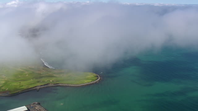 ws aerial view of clouds over reykjavik city with bay / iceland - reykjavik stock videos and b-roll footage