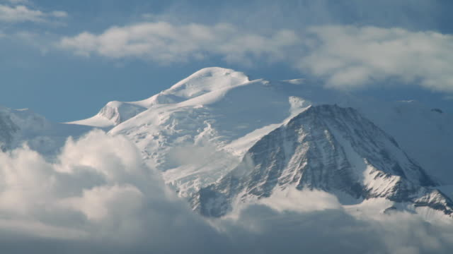 ws view of clouds passing over mont blanc at early morning / chamonix, haute savoie, france - mont blanc stock videos & royalty-free footage