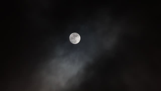 ws t/l view of clouds passing over moon /vestal, new york, united states - moon stock videos and b-roll footage