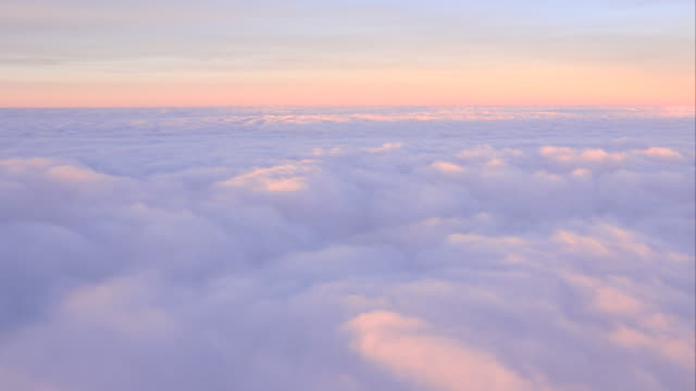 WS AERIAL POV View of cloudscape against sky at dawn