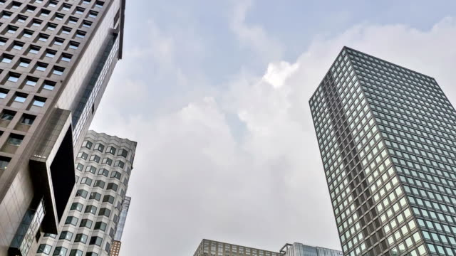 view of cloudscape over buildings in jongno-gu - low angle view stock videos & royalty-free footage