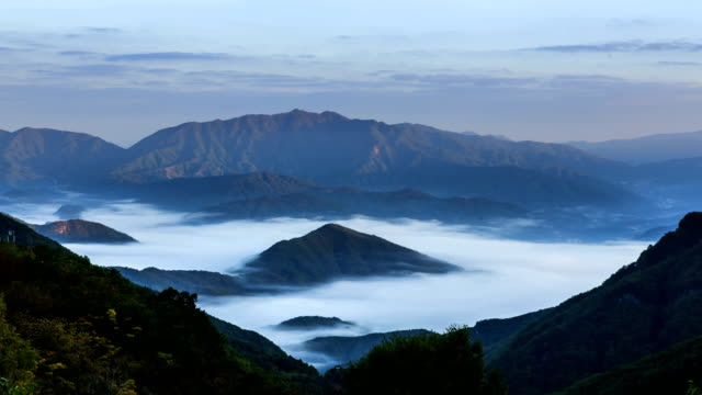 view of cloudscape over mountain range at gapyeonggun in gyeonggi-do - dramatic sky stock videos & royalty-free footage