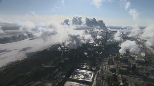 WS POV AERIAL View of cluster of clouds above Oil Sands Operational facility in Alberta / Fort McMurray, Alberta, Canada