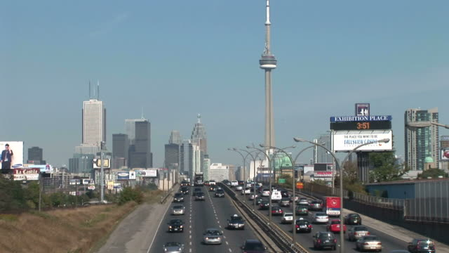 View of CN Tower from highway in Ontario Toronto Canada