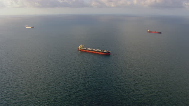 WS AERIAL TS View of coal cargo ship in ocean / Queensland, Australia
