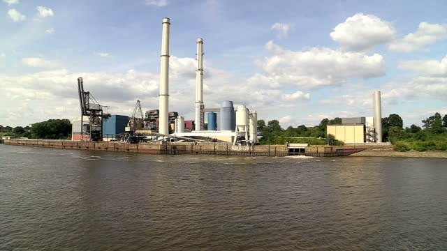 ws pov view of coal power plant wedel near river elbe, schleswig holstein, germany / hamburg, germany - schleswig holstein stock videos & royalty-free footage