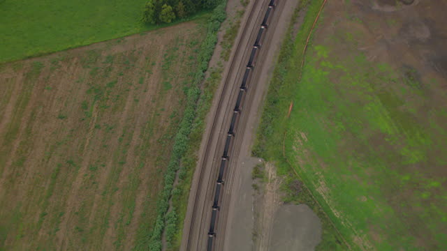 ws aerial view of coal train / mandalong, new south wales, australia - rail freight stock videos and b-roll footage