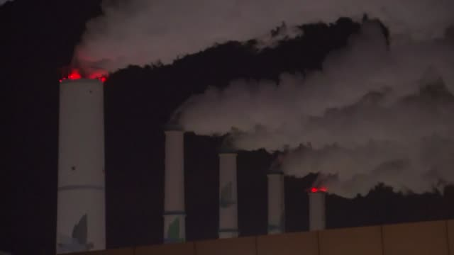 view of coal-fired power station and chimney smoke in taeangun, chungcheongnam-do, south korea - power station stock videos & royalty-free footage