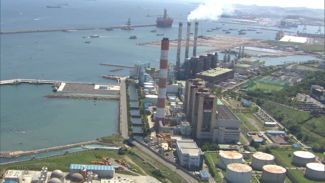 view of coal-fired power station in ulsan at daytime - south korea stock videos & royalty-free footage