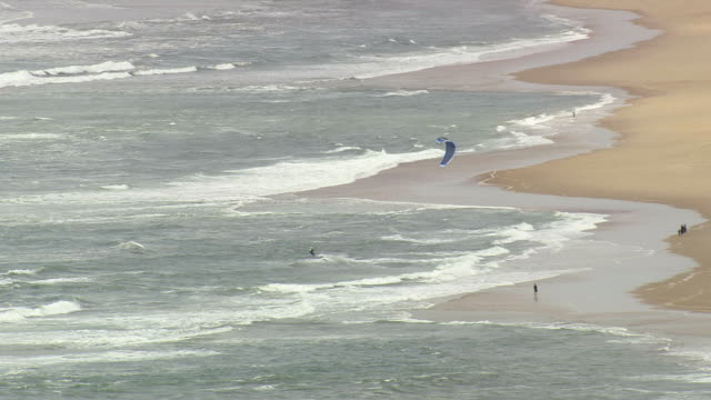 ws aerial zo view of coast and surf kites / aquitaine, france - aquitaine stock-videos und b-roll-filmmaterial