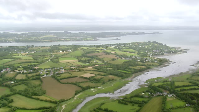 ws aerial view of coast east of brest with river inlets and farm fields / brittany, france - finisterra bretagna video stock e b–roll