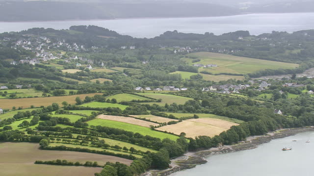 WS AERIAL View of Coast East of Brest with river inlets and farm fields / Brittany, France