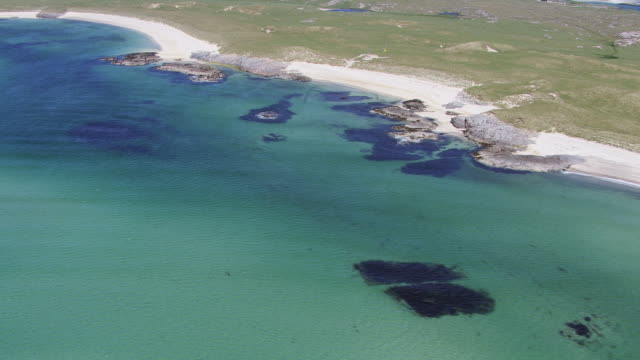 WS AERIAL View of coast of Hebrides on west coast showing lovely sandy beaches / Isle or island of Coll, Argyll and Bute, Scotland