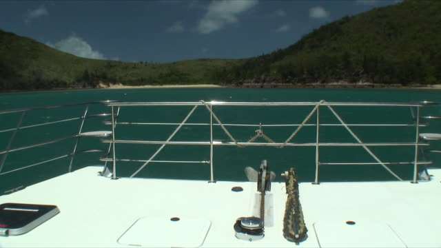 MS View of coast past rear deck of boat, Whitsunday Islands, Queensland, Australia