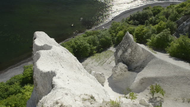 ws view of coast with chalk cliffs at stubbenkammer at jasmund national park, unesco world heritage site / sassnitz, rugen / mecklenburg-western pomerania, germany  - calcium carbonate stock videos and b-roll footage