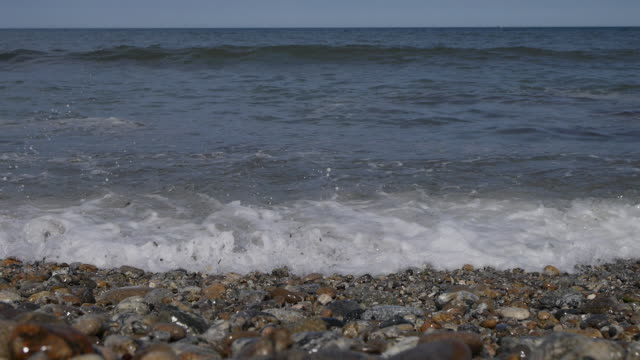 view of coastal feature and waves - coastal feature stock-videos und b-roll-filmmaterial