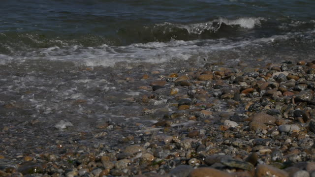 stockvideo's en b-roll-footage met view of coastal feature and waves with the boulders - coastal feature
