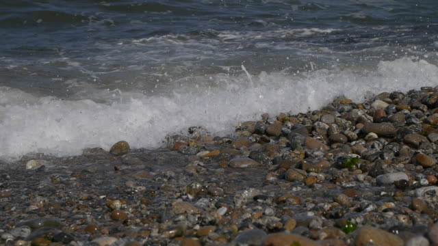 view of coastal feature and waves with the boulders - coastal feature stock-videos und b-roll-filmmaterial