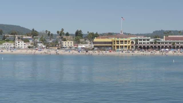 view of coastline and beach from municipal wharf, santa cruz, california, united states of america, north america - カリフォルニア州サンタクルーズ点の映像素材/bロール