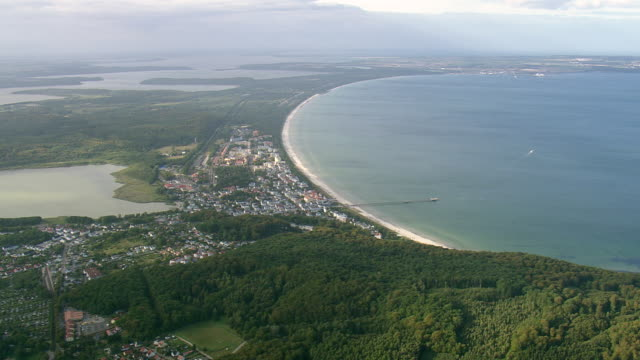ws aerial view of coastline and town at binz / germany - rügen stock videos & royalty-free footage