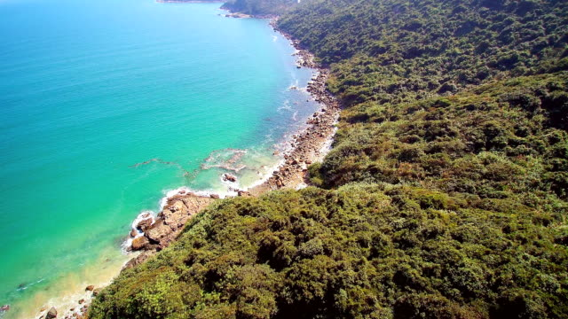 WS AERIAL POV View of coastline area with lush area / Hong Kong, China