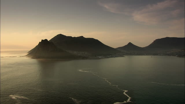 ws view of coastline at sunset / cape town, western cape, south africa - cape town stock videos & royalty-free footage