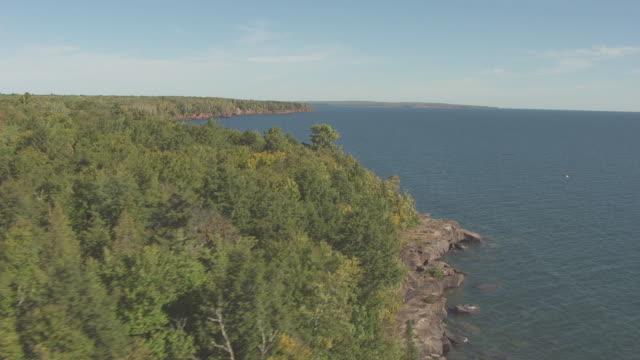 ms aerial view of coastline of stockton island / wisconsin, united states  - lago superiore video stock e b–roll