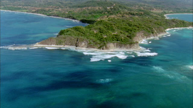 aerial view of coastline surrounded by ocean / guanacaste, costa rica - costa rica stock videos and b-roll footage