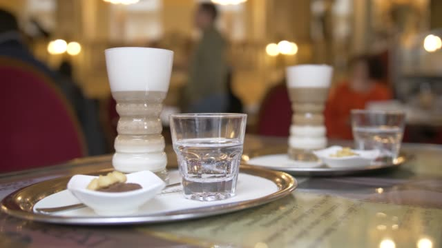 stockvideo's en b-roll-footage met view of coffees in ornate interior of new york cafe, budapest, hungary, europe - traditionally hungarian