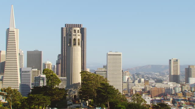 ms ds zo aerial view of coit tower with downtown / san francisco, california, united states - coit tower stock videos & royalty-free footage