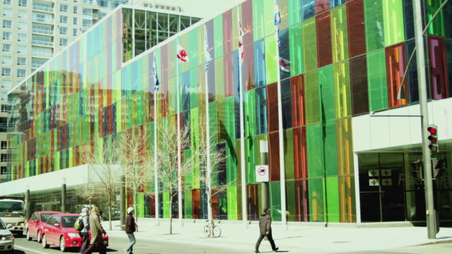 ms view of colored glass windows of palais des congres de montreal / montreal, quebec, canada - street name sign stock-videos und b-roll-filmmaterial