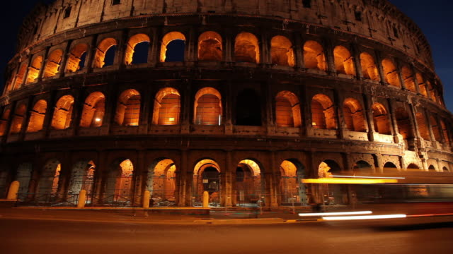 ms t/l view of colosseum at dusk / rome, lazio, italy  - colosseo video stock e b–roll