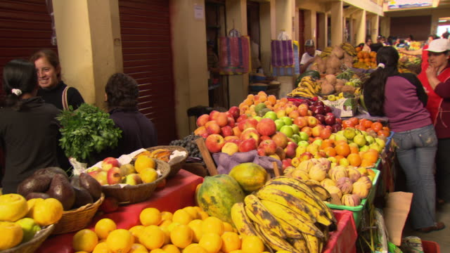 """View of colourful market stalls selling fresh produce, Chachapoyas market, Chachapoyas, Peru [Perú]"""