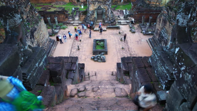ms t/l ha view of colourful tourists carefully descending steep steps at pre rup temple ruin / angkor wat, cambodia - steep stock videos & royalty-free footage