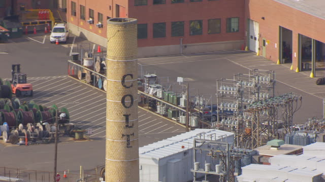 WS AERIAL POV ZO View of COLT sign on the factory smokepipe, with Colt Armory and Colt Manufacturing Company building in city / Hartford, Connecticut, United States