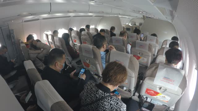 view of commercial airliner interior - passenger seat stock videos & royalty-free footage