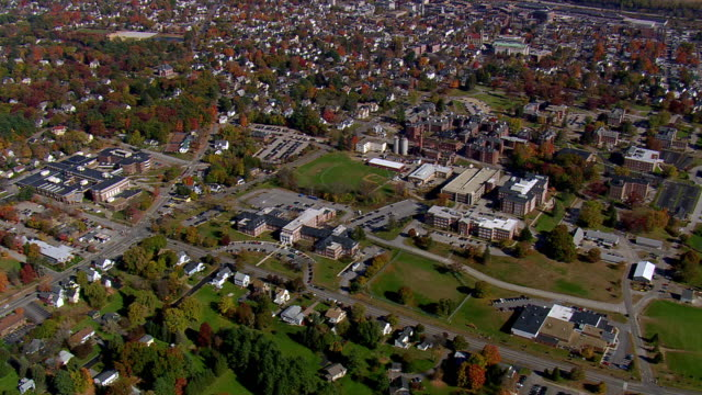 ws aerial zi view of concord town with autumn color trees / new hampshire, united states - new hampshire stock videos & royalty-free footage
