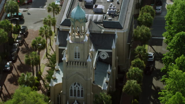 ms aerial pov zo view of congregation mickve israel, gothic synagogue / savannah, georgia, united states - temple building stock videos & royalty-free footage