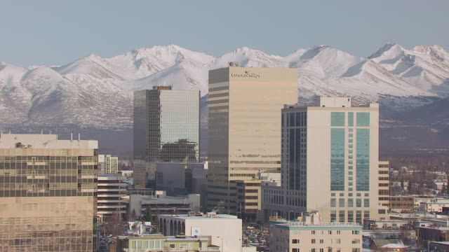ws aerial ds view of conoco phillips building and downtown with mountains / anchorage, alaska, united states - anchorage alaska stock videos & royalty-free footage