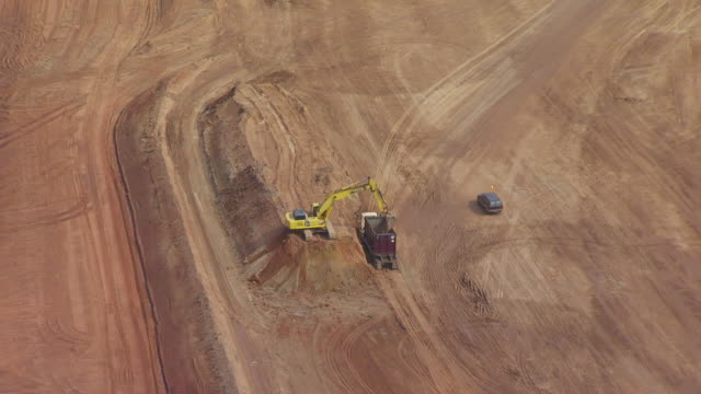 ms aerial zo view of construction machine working at mill tailing site of umtra project / moab, utah, united states - moab utah stock videos & royalty-free footage