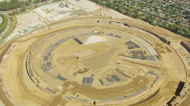 WS ZI AERIAL POV View of construction site, Apple Headquarters / Cupertino, California, United States