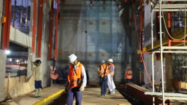 view of construction site defocused. - steel worker stock videos & royalty-free footage