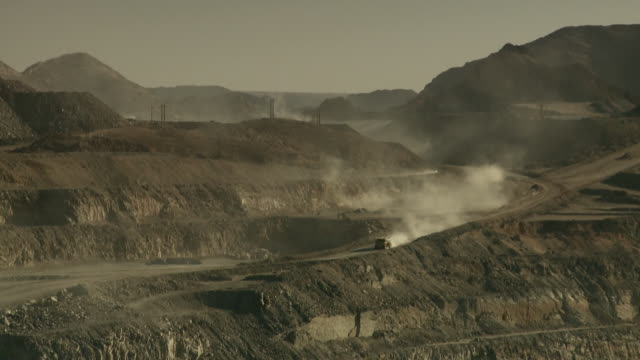 WS View of construction vehicle driving through opencast mine / Namibia