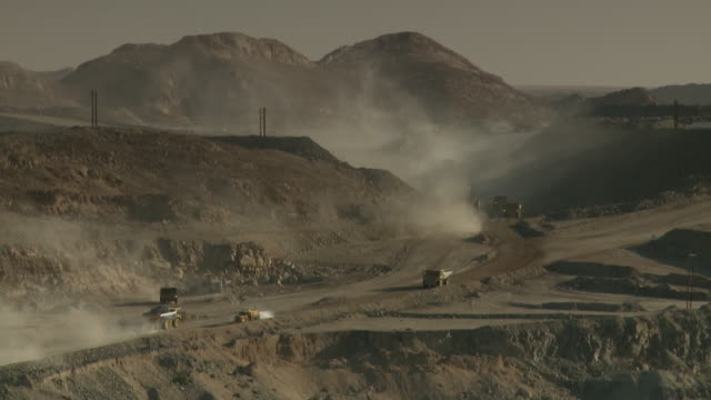 WS View of construction vehicles driving on opencast mine / Namibia