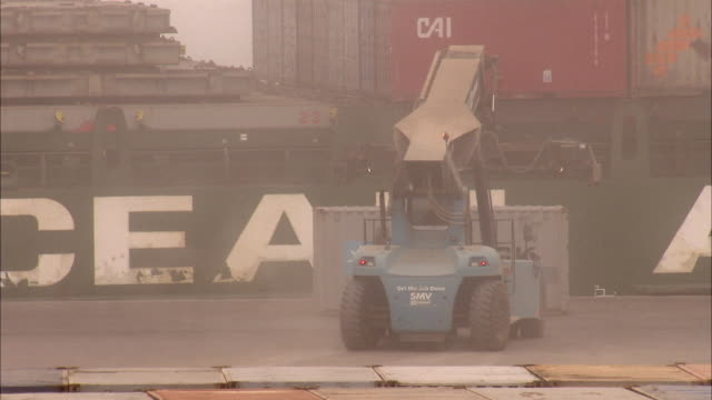 MS View of container ship being unloaded in dense fog / Luderitz, Namibia