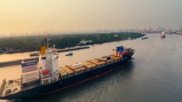 View of container ship travelling in river